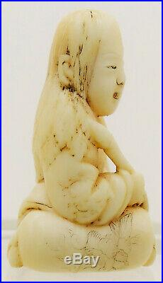 An Antique Japanese Carved Netsuke of a Boy Meiji Period 19th Century Signed