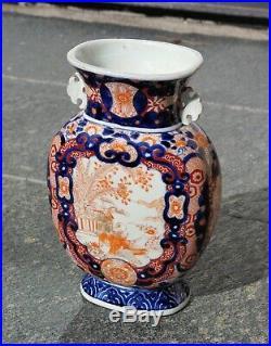 An Antique Pair of Japanese Meiji Period Imari Porcelain Vases