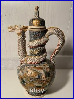 Antique Japanese Satsuma Kyoto ware wine pot with a Dragon design marks on base