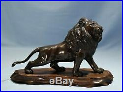Japanese Meiji Period Patinated Bronze Figure of a Lion Circa 1900 Wooden Base