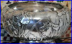 Large Japanese Sterling silver repousse bowl with Irises. Meiji period