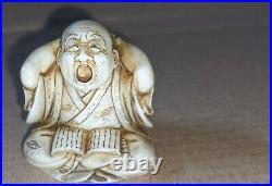 Meiji period Japanese fine carved Boxwood Netsuke of a yawning man reading