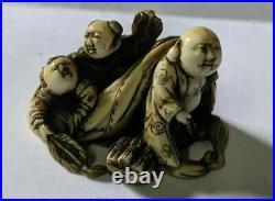 Meiji period Japanese okimono depicting a man with two boys in sack