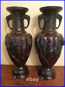 Meiji period japanese pr of bronze vases cast in relief with birds and flowers